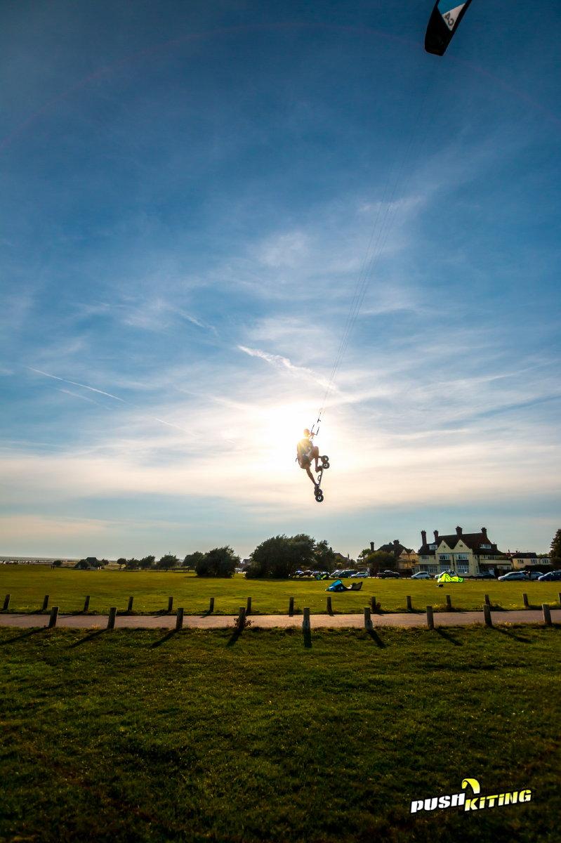 Aj Grab through the sun kite land boarding